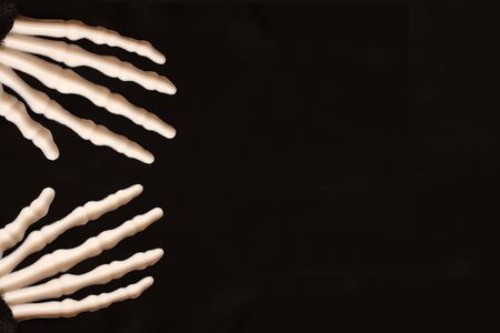 Skeletal hands on black background with copy space, death and mistery concept, halloween.