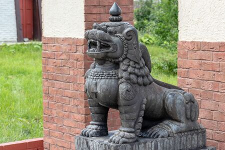 Stone traditional guard lions near the temple in the ethnic centre.