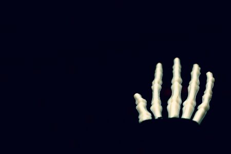 Skeletal hand on black background with copy space, death and mistery concept, halloween. Stok Fotoğraf