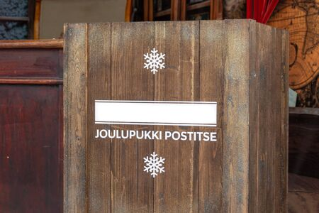A wooden mailbox for joulupukki - skandinavian santa claus, children writes letters with their wishes to him before christmas. Banco de Imagens