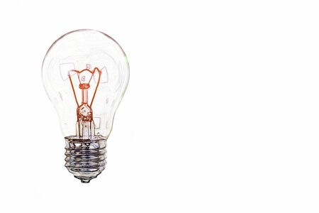 Transparent incandescent lamp bulb with red heated spiral on white background with copy space.