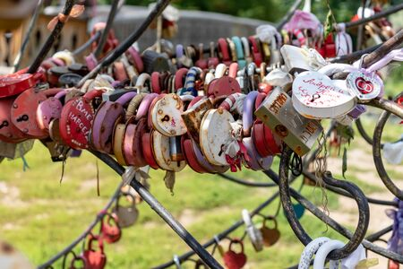 Moscow, Russia - August 03, 2019: Many wedding multicilored locks, castles on a wedding tree as a symbol of eternal love and happiness. Reklamní fotografie - 137615845