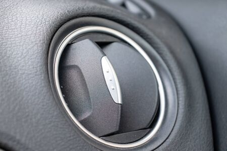 Car vent, air conditioner or climate control nozzle close up.