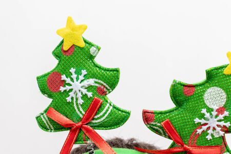 Textile green christmas tree wuth decorations on white background - xmas party concept. Reklamní fotografie