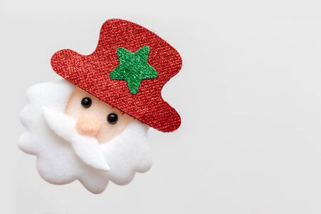 Textile symbol of christmas and new year santa claus on white background with copy space. Reklamní fotografie - 137125029