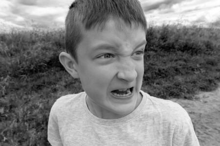 Child abuse, teen boy frightened and running away from bulling. Reklamní fotografie - 137125037