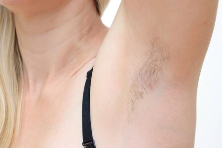 Hairy unshaved anderarms, armpit of a caucasian woman close up.