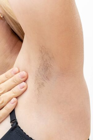 Hairy unshaved anderarms, armpit of a caucasian woman close up. Reklamní fotografie - 137126708