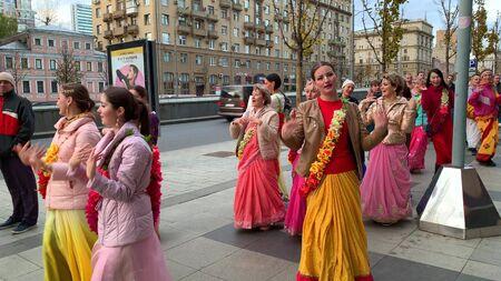 Moscow, Russia - November 12, 2019: Hari Krishna people, women in colorful sari walk along the street, sing and dance, holiday parade of Krishnas Reklamní fotografie - 137708912