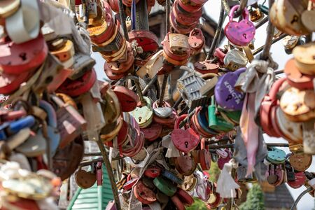 Moscow, Russia - August 03, 2019: Many wedding multicilored locks, castles on a wedding tree as a symbol of eternal love and happiness. Reklamní fotografie - 137814692