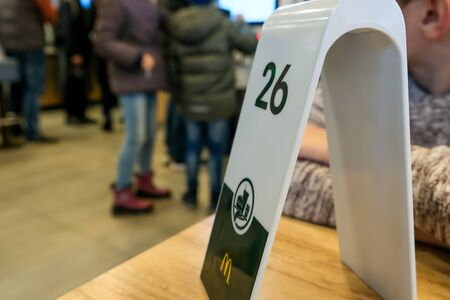 Moscow, Russia - December 14, 2019: Order number on the table at McDonalds fastfood restaurant. Redakční