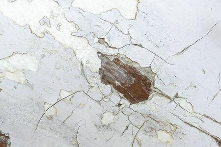 White peeling paint background with spots of peeking wood base Reklamní fotografie