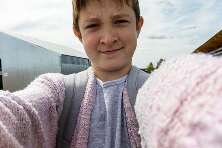 A portrait of a preteen boy making selfie, summertime, he is travelling during summer vacation. Reklamní fotografie