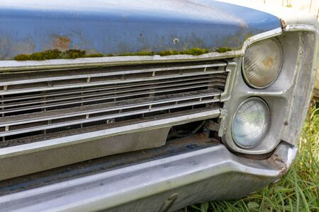 Front side of an old rusty car with head light, auto repair concept. Reklamní fotografie