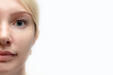 Woman face with perfect retouched skin - concept of rejuvenating cosmetological procedures of biorevitalization, face lifting and pigment spots removal, white background, copy space. Reklamní fotografie - 141245629