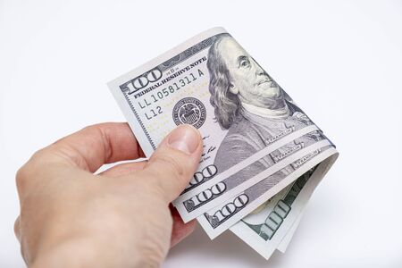 Hand holding folded american us dollar banknotes, saving money concept. Reklamní fotografie