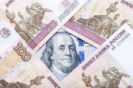 American us dollars lying among russian rubles. Reklamní fotografie - 141989147