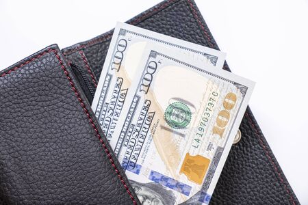 Us dollars in a wallet, saving money concept.
