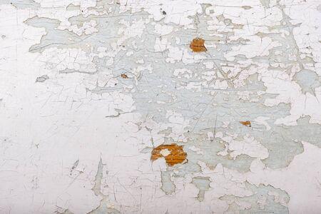 White peeling paint background, old paint texture.