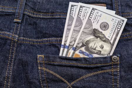 American us one hundred dollar banknotes in a pocket. Reklamní fotografie - 141817330