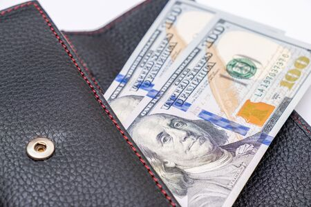 Us dollars in a wallet, saving money and wealth concept.