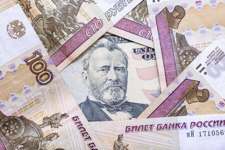 American currency usd among russian ruble rub paper banknotes, the choice of currency for saving money and wealth. Reklamní fotografie - 141989191