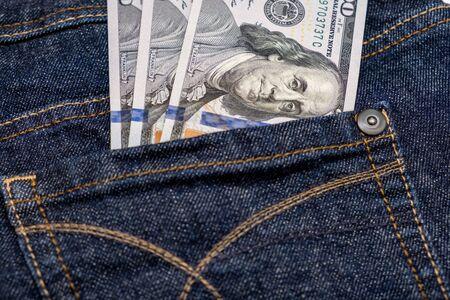 American us one hundred dollar banknotes in a pocket. Reklamní fotografie - 141916641