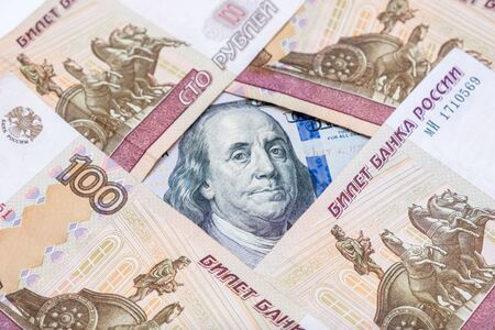 Russian rubles rub and american dollars usd exchange rate concept, ruble devaluation and financial loss .