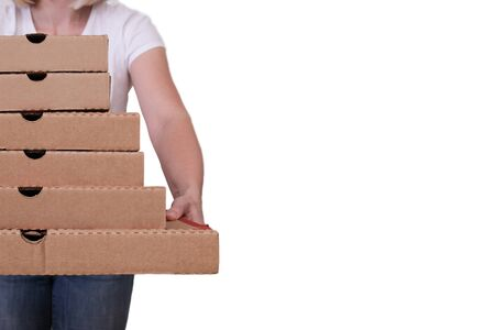 Woman holding many pizza boxes of different sizes, white background, copy space.