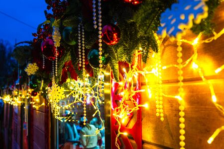 Christmas decorations and garlands on the street, illuminated winter holiday city decor.