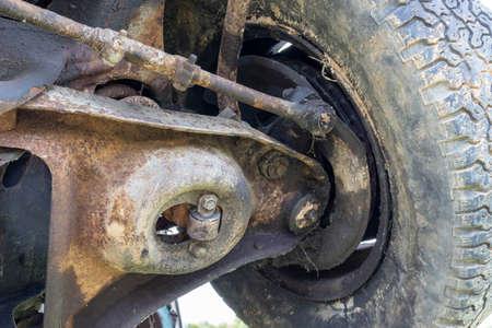 Car suspension SUV repair, bottom view of a rusty parts of automobile. Reklamní fotografie