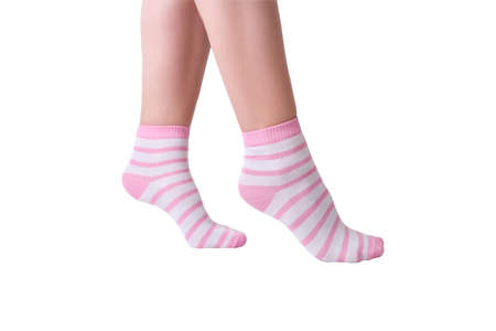 Woman female legs wearing pink and white striped plain cotton socks of classic style with elastic band isolated on white. Reklamní fotografie - 160024358