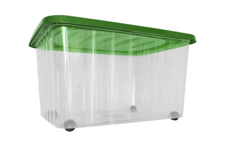A transparent big plastic portable container, storage box on wheels with green cover for general purpose, household equipment isolated on white.