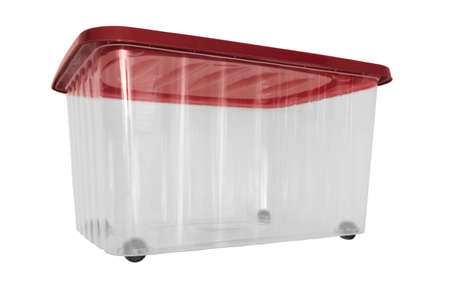 A transparent big plastic portable container, storage box on wheels with red cover for general purpose, household equipment isolated on white.