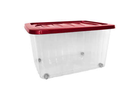 A transparent big plastic portable container, storage box on wheels with red cover for general purpose, household equipment isolated on white Reklamní fotografie