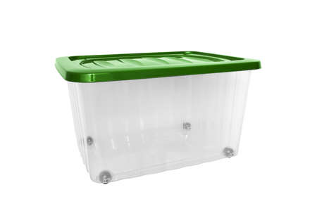 A transparent big plastic portable container, storage box on wheels with green cover for general purpose, household equipment isolated on white Reklamní fotografie