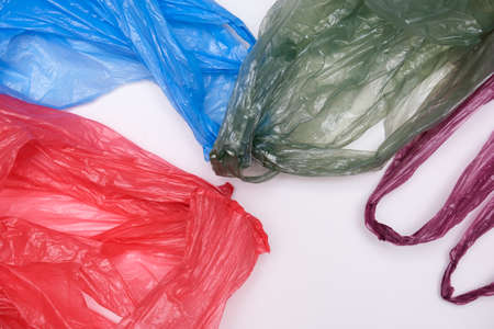 Plastic bags waste on white background, plastic recycling concept