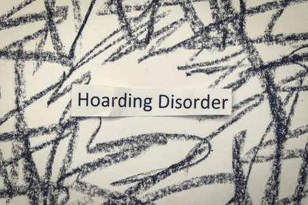 Hoarding disorder handwritten sign mental health problem when people collect different useless things and waste and bring them home Imagens