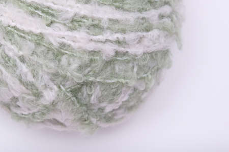 Light green yarn, pale pastel color woolen yarn on white background
