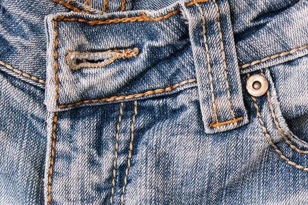 Shabby blue jeans background with fore pocket, denim fashion background. Reklamní fotografie