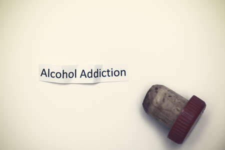 A sign alcohol addiction with a cork, bad habbits overcoming concept