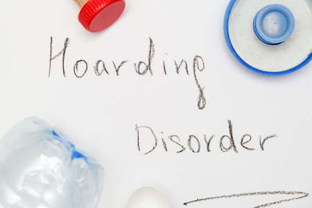 Hoarding disorder concept, mental health problem when people collect different useless things and waste and bring them home, a sign surrounded with junk