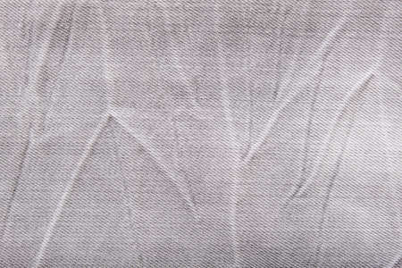Gray shabby jeans denim background, texture of grey denim close up