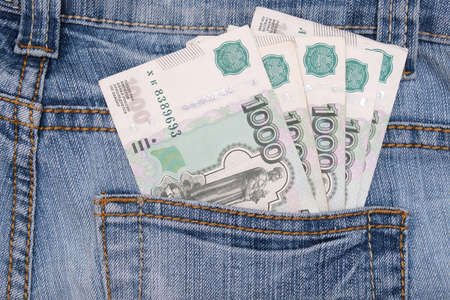 Paper 1000 banknotes of russian rubles in a jeans pocket
