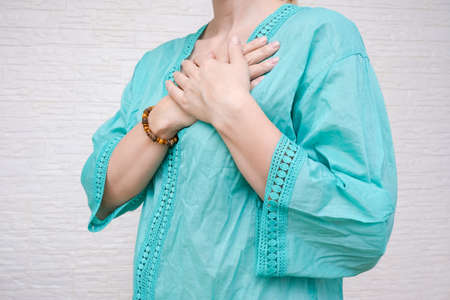 Woman expressing gratitude with hands.