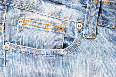 Shabby blue jeans background with fore pocket, denim fashion background