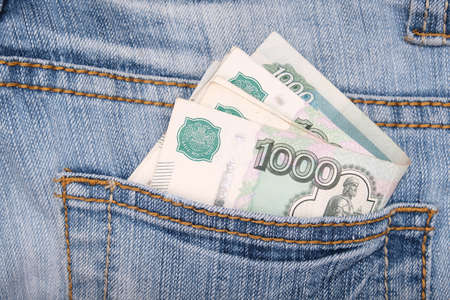 Paper 1000 banknotes of russian rubles in a jeans pocket, inflation rate concept Фото со стока