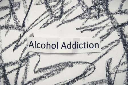 A sign alcohol addiction on anxious crosshatched background