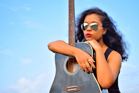Young Indian girl with guitar, Pune Stock Photo