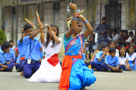 Girl students perform Lazim excercises or drill during independence day in Pune